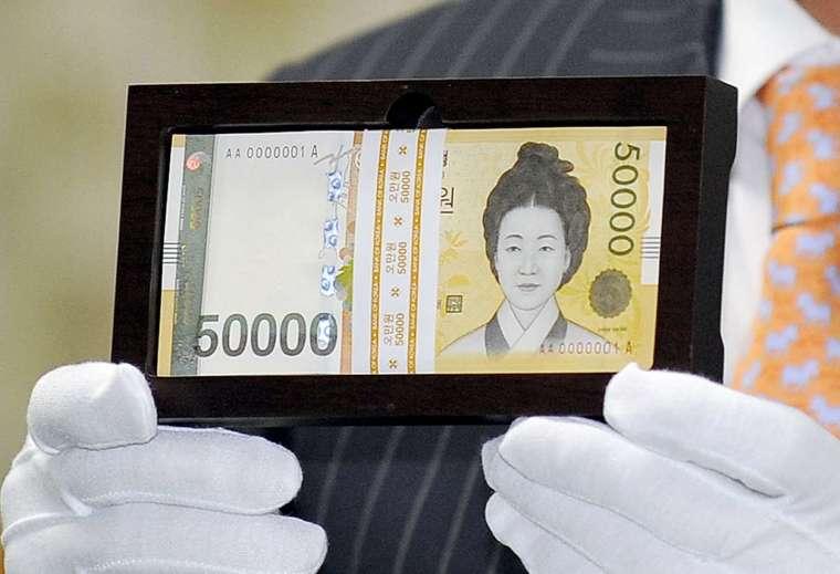 南韓央行 8 月升息迄今,未能止住韓元走貶。(圖: AFP)