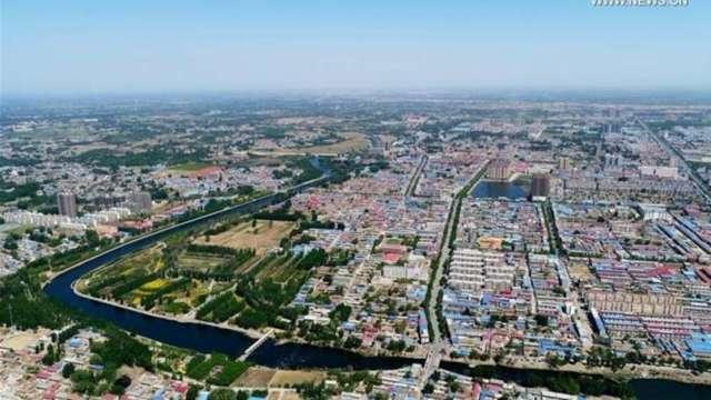 房市降溫 上海進行土地拍賣平均溢價率不到3.5%(圖片:AFP)